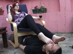 slave licks boots and feet
