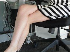 milky legs under table