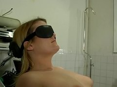 Small tits chick bound to a chair for a BDSM session