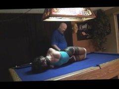 Lara Croft model tied up on pool table