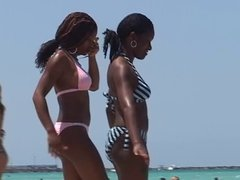 Black girls in swimsuits partying and swimming