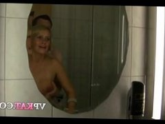 Mature German blonde with short hair is taking a shower