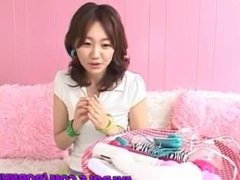 Pretty Asian milf, Rin gets pussy teased with several sex toys