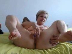 Blonde granny masturbates with dildo on webcam