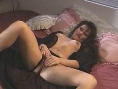 Hot sexy slut on the bed fingers fucks her pussy deep