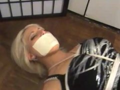Tape Gagged Bondage in Latex