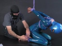 MILF in Latex Catsuit Armbinder Bondage in Hood