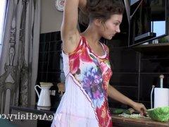 Simona strips and masturbates in kitchen