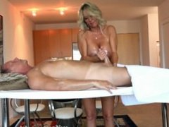 Busty MILF Gives Oil Massage And Handjob