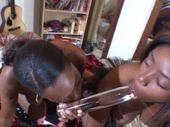 2 ebony lesbians using a strap-on