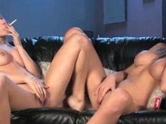Two blonde girls smoking and masturbates