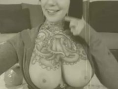 big boobed tattooed girl playing with tits and nippletorture