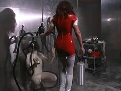 Mistress places guy in latex suit