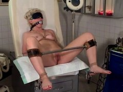 Blonde with a nice rack in BDSM session involving clothes pegs