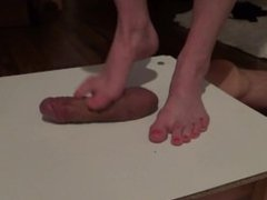 bare feet massaging big cock