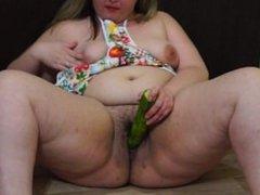 fatty fucks herself cucumber in the kitchen