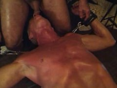 Restrained on work bench and sucking buddy
