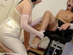 Sexy MILF demonstrates how to tie up a brunette hottie