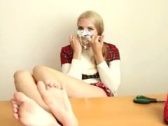 Blonde girl self-gags and shows bare feet