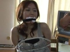 Layered gags for a Japanese woman
