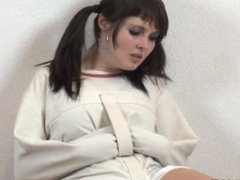 Girl with pigtails in straitjacket