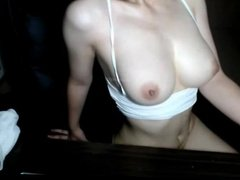 Korean girl shows her bouncy tits on a webcam
