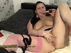 granny onlinecams Busty mom wearing a single stocking plays with a gold