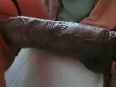 Fucking herself with a Big Black Dildo
