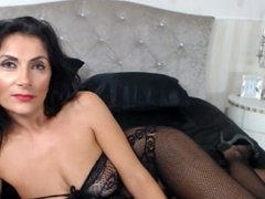 Raven Haired Milf In Sexy Body Suit Teases