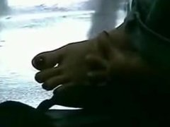 candid asian toe spread  under table