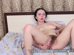 Mina Lin gets that toy in her hairy pussy