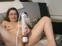 Amateur has orgasm with vibrator on cam