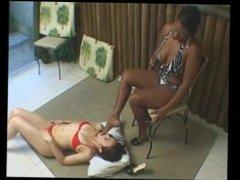 Black woman makes white girl lick her feet
