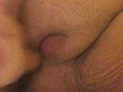 Penetrating my pussy lips with a fat dildo