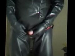Filling a bag with piss then drink it and play with my cock in rubber.