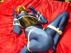 Simone tied tightly in blue spandex