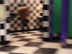 jack behind guy in bathroom