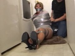 Cleo surprised and ducttaped in the laundry room!