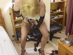 Sissy riding black dildo . Chastity stockings