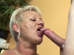 Blonde granny in stockings arouses the mechanic