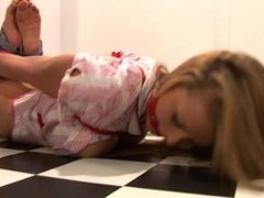 Hogtied, ring-gagged, and left to struggle in the back room