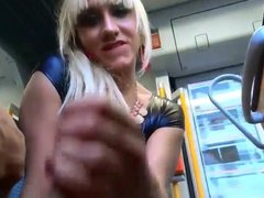 Girl jerks a lucky guy cock on the bus