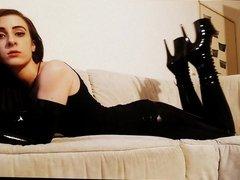 Girl in black latex smocking