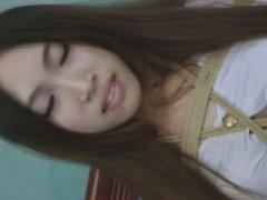 Chinese babe in bondage and ballgagged