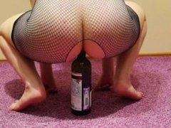 Brunette fucks her ass bottle
