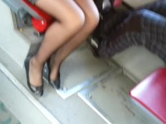 Tight miniskirt sheer black pantyhose and flats
