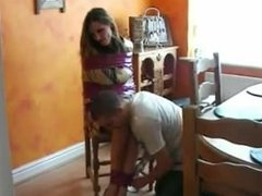 Girl wrapped with tape on the chair