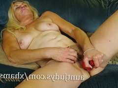 Cristine Ruby Teases Her Pussy with a Red Toy