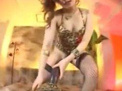 Japanese cowgirl fucks huge brown dildo
