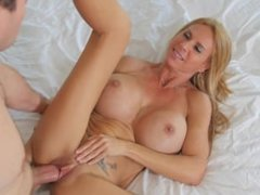 Busty milf enjoys sex with younger man